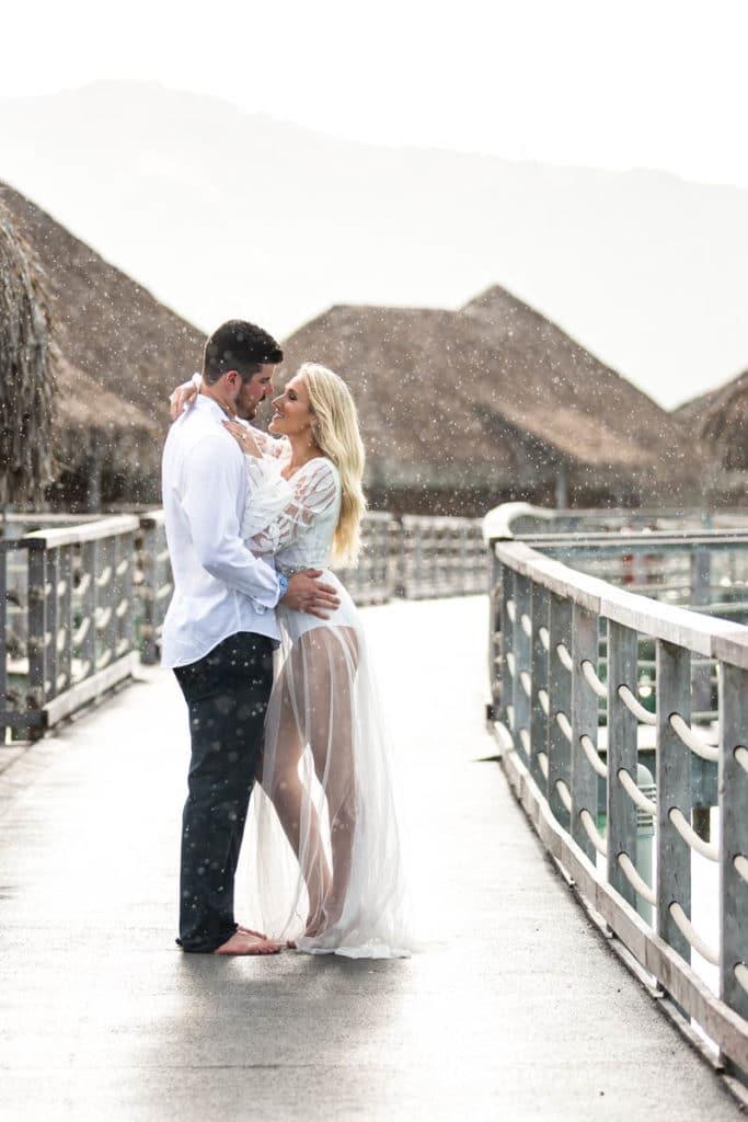 Couple under the rain in Bora Bora