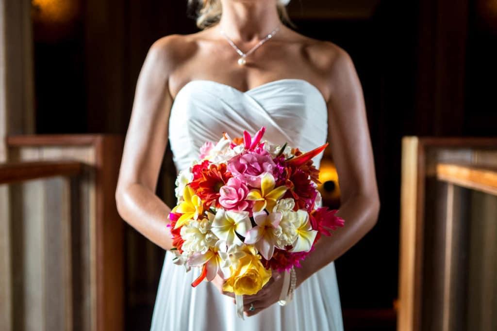 bora bora bride holding a tropical bouquet