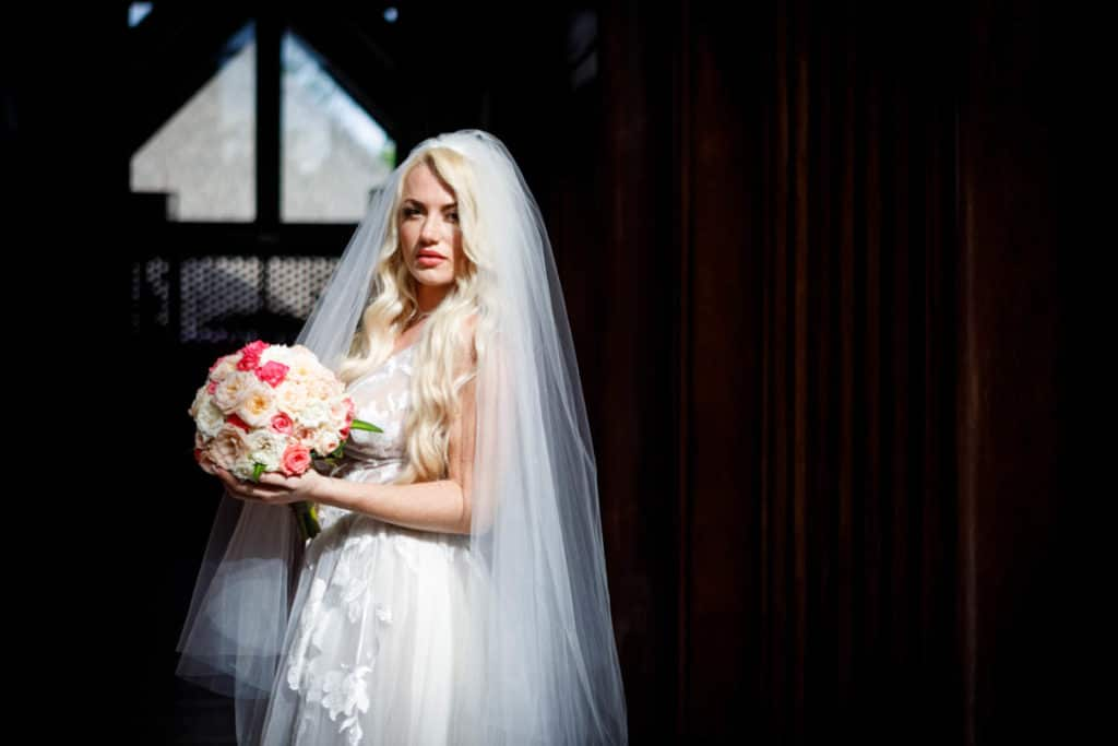 bora bora bride with a short round bouquet