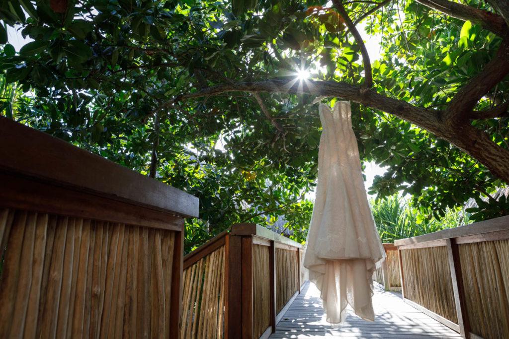 wedding dress hanging on a tree at Four Seasons resort Bora Bora