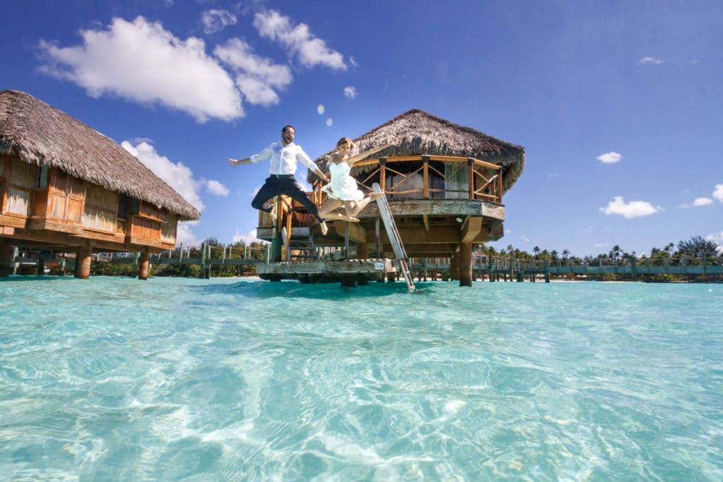 Lena & Austin jumping in the lagoon of Bora Bora