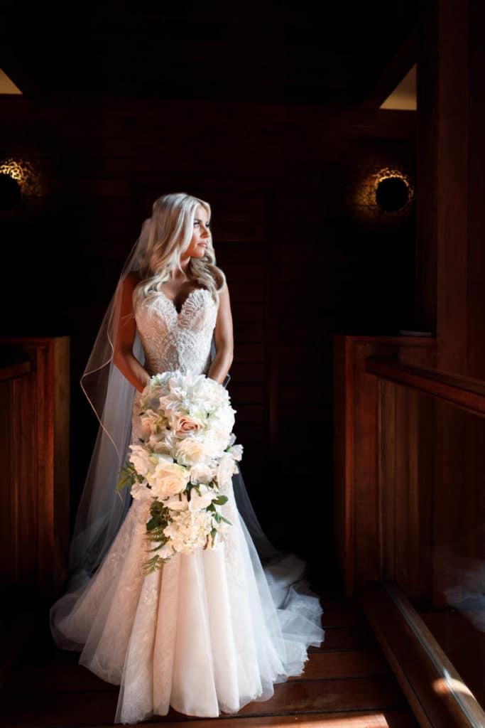 bora bora bride with a long bouquet