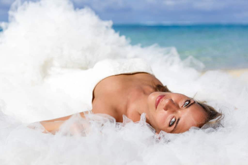 bride lying on the sand