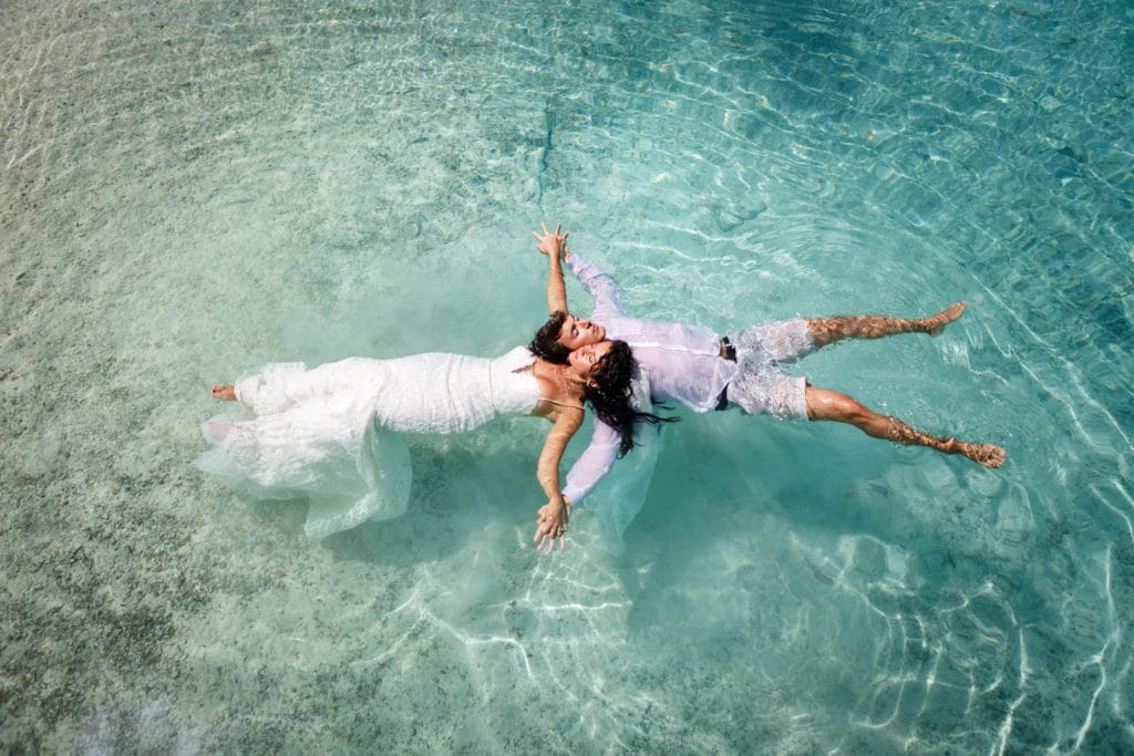 Trash the wedding dress floating in the lagoon of Bora Bora