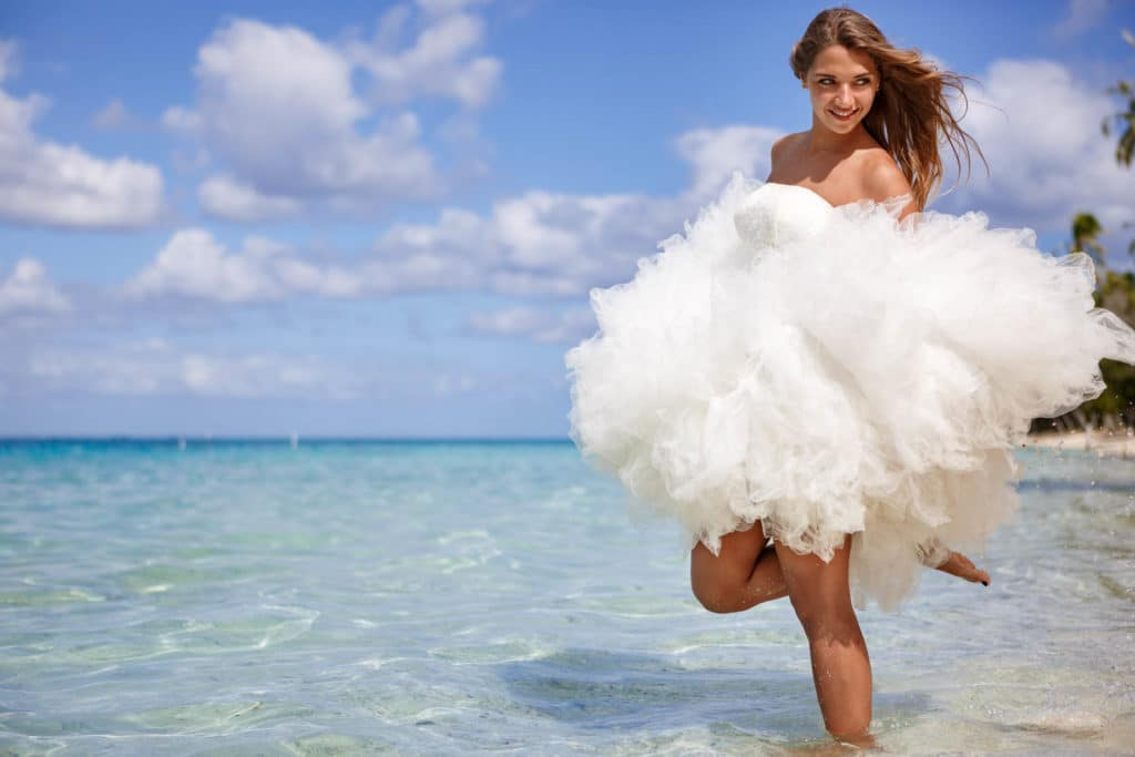 Beautiful Bora Bora bride playing with the dress