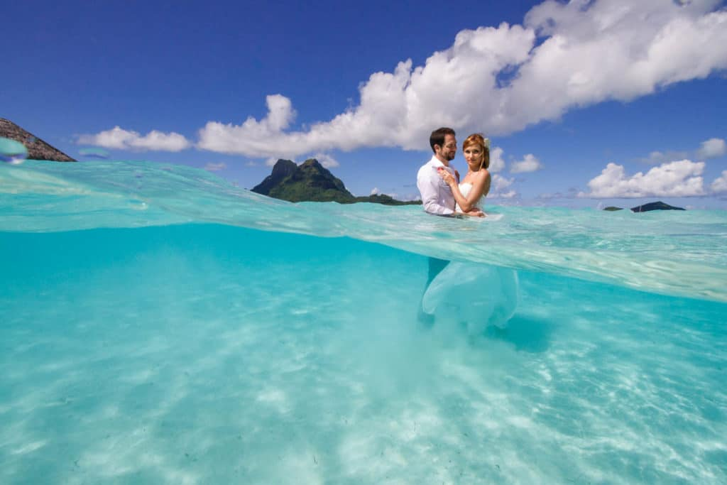 Bride and groom doing a Trash the wedding dress session at the Pearl Beach Resort Bora Bora