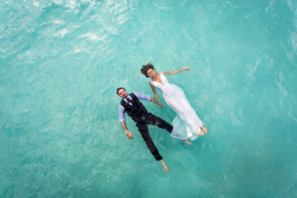 couple floating in the lagoon of Bora Bora