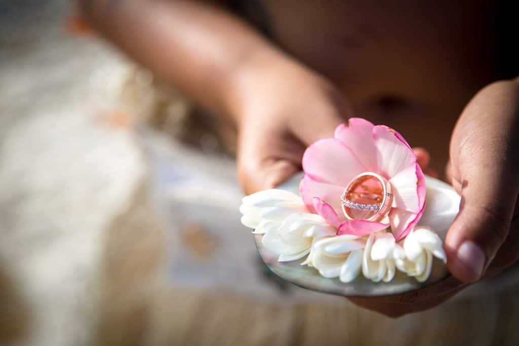 rings presented on top of flowers