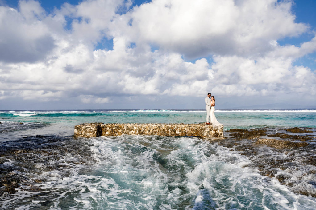 couple on top of the bridge of the ocean side at the St Regis Resort Bora Bora