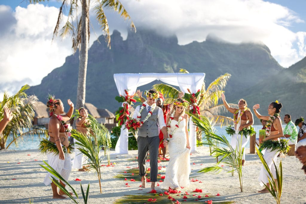 Polynesian ceremony on sunset motu at Four Seasons resort Bora Bora
