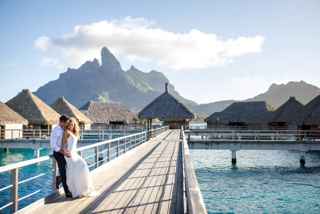 couple posing on the bungalow side