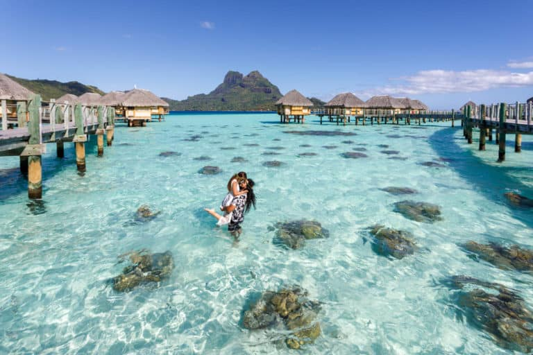 couple posing at pearl beach bora bora