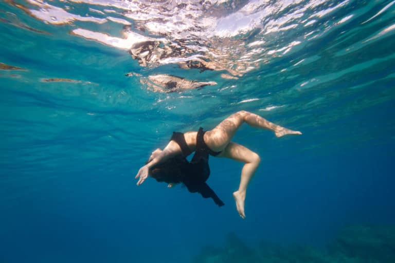 underwater women floating in the lagoon of bora bora